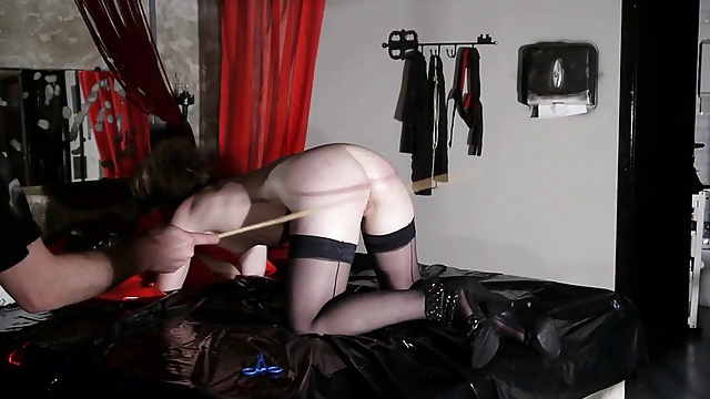 french submissive libertine in bdsm caning session bdsm