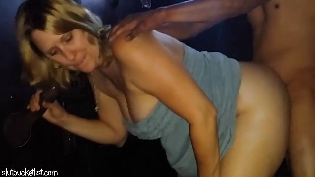 SatiSlut – MILF fucked at glory hole in the adult theater.